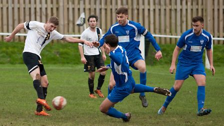 Action from Swaffham Town's 3-1 home win over Brantham Athletic (blue) at Shoemakers Lane, Joe Jacks