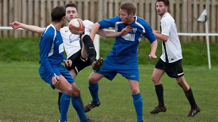 Action from Swaffham Town's 3-1 home win over Brantham Athletic (blue) at Shoemakers Lane, Luis Duar
