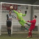 Action from Swaffham Town Reserves' 2-1 loss to Hemsby at Shoemakers Lane, Aaron Watson in arial act