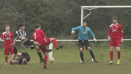 Action from Swaffham Town Reserves' 2-1 loss to Hemsby at Shoemakers Lane, Toby Millward up-ended fo