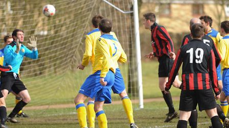 Farmhouse (red) against Acle Rangers in the Norwich Sunday League. Farmhouse score a goal. Picture: