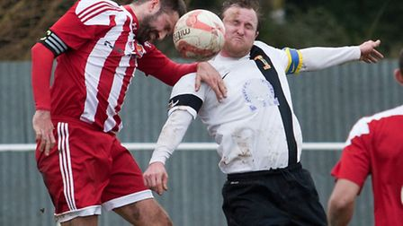 Action from Swaffham Town's 4-2 home defeat to Felixstowe and Walton United (red) at Shoemakers Lane