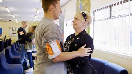 21yr old prisoner Liam Poore hugs his mum during visiting at HMP Norwich. Photo: ITV