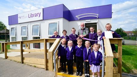 Children's author Wes Magee helps open the new library at Norwich Primary Academy.