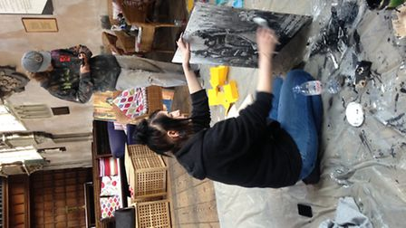Photograph shows OPEN's Maisie Payne working on her joint creation with Anmar Mirza with Liam Clark