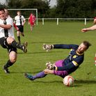 Jack Defty scores one of his three goals during Swaffham Town's 4-1 win over Newmarket Town at Shoem