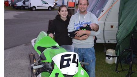 Watton racer Ben Squire, pictured with new baby Zach, enjoyed a successful weekend at Cadwell Park i