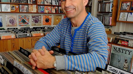 Eric White in his record shop Out of Time in Magdalen Street, which he has been running for 30 years
