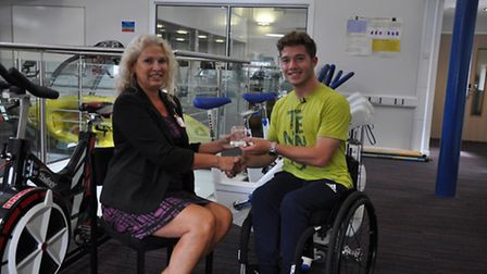 Principal Corrienne Peasgood presenting Alfie Hewett with his City College Norwich Further Education