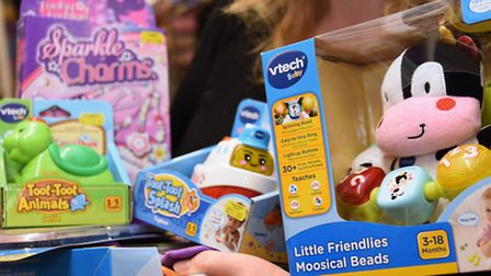 Toys being chosen for the 100 toys that Langleys are donating for the Evening News' Christmas Presen