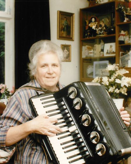 Pat Siano with her accordion on the 29th May 1992. Photo by Archant Library
