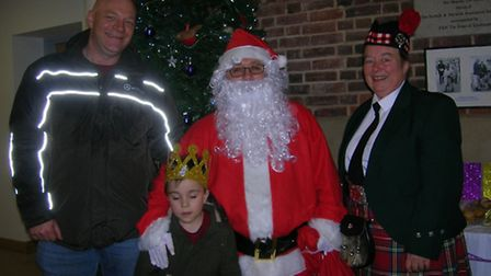 The tricker, Santa and drummer from Phoenix Band plus one of YoungEyes youngsters at the Christmas G