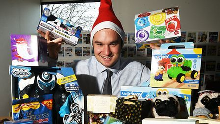 Reporter Nicholas Carding with some of the gifts donated by Norwich Evening News readers to the Send