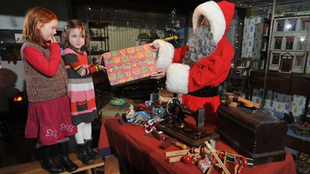 Naima Tyler-Berry and Eleanor Richardson have a chance to meet Father Christmas in his toy workshop