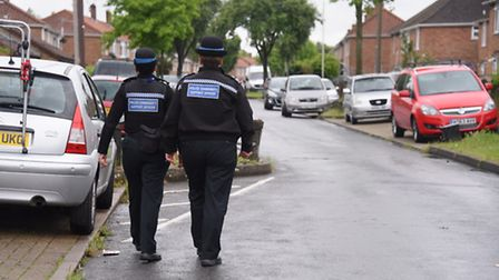 Police patrol Motum Road after the disturbance which took place there. Picture: DENISE BRADLEY