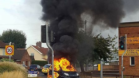 Firefighters at the scene of the car fire on Reepham Road. Picture: Spot that Dog! ?@ooBeeB 2h