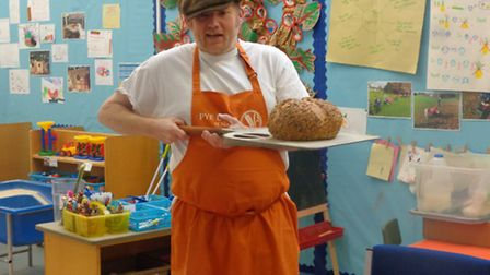 Grimsby talking to the children about being a baker. Picture: courtesy of Nelson Infant School