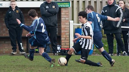 Double goal scorer Korben Willis on the attack under the watchful eyes of Nathan Pack and Chris Cart