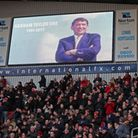Players and fans take part in a minute's applause in memory of former England Manager Graham Taylor
