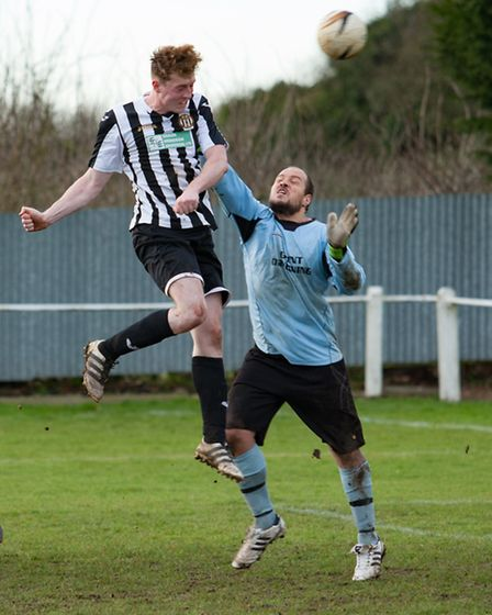 Swaffham Reserves' Kurtis Callaby beats the Freethorpe keeper to the cross. Picture: EDDIE DEANE
