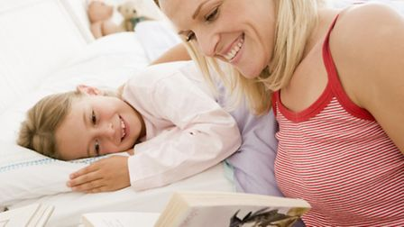 Thing of the past? A mum reads her daughter a comforting bedtime story. These days, so many of our c