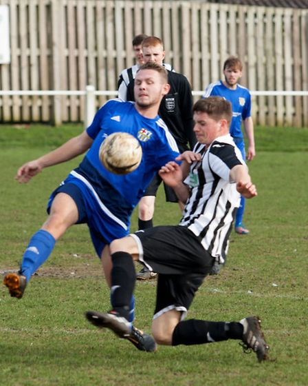 Danny Nichols giving 100pc commitment for Swaffham Reserves. Picture: Eddie Deane.
