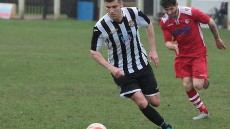 Swaffham own's recent signing Alan Woodcock on the attack. Picture: Eddie Deane.
