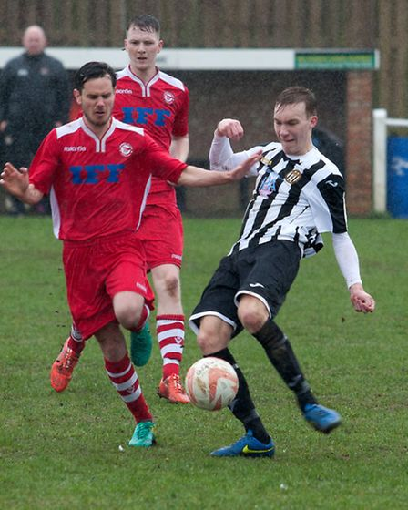 Toby Millward, stripes, is first to the ball for Swaffham. Picture: Eddie Deane
