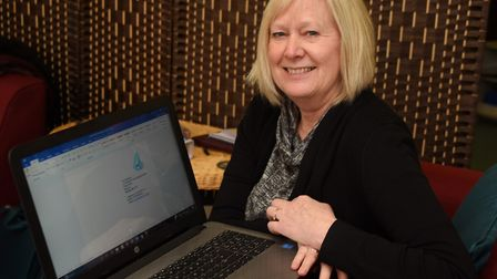 Kathryn Habershon, director of 4Cs Counselling Service, with the laptop they bought with Comic Relie