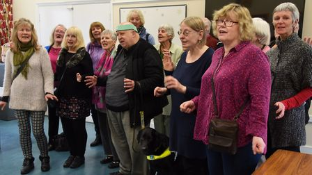 The Sing Your Heart Out volunteer-run group who have benefitted from Comic Relief, in full voice. Pi