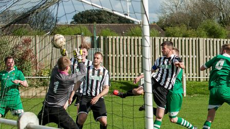 Swaffham Reserves' Sam Loomes with an attempt at goal,