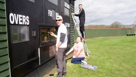 The scoreboard gets some attention at Great Melton Cricket Club's CricketForce Day. Picture: STEVE P