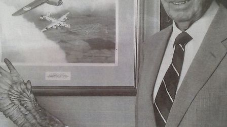 The late Bernard Matthews with the painting the 2nd Air Division Memorial Library Trust presented to