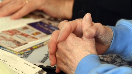 Hands on the memory books at the first Harleston and District Dementia Friendly Community Cafe. PICT