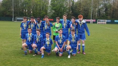 Attleborough Town U14s celebrate their cup win at the FDC. Picture: Club
