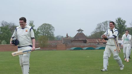 Great Melton A's Lee Whiddett and Jonathan Ellse leave the field after victory over Lowestoft A. Pic