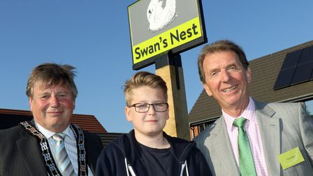 (from left) Colin Houghton, Elliot Clark and Tony Abel in front of the new village sign at Swan's Ne