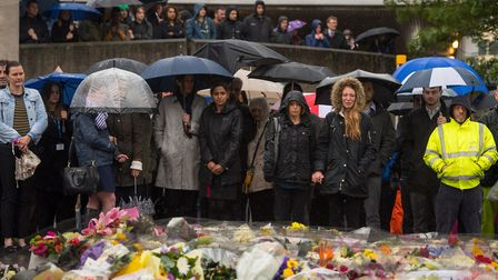 People observe a minute's silence on London Bridge in honour of the terror attack victims who died i