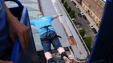 Stuart Blandford launches himself from the cage in a 160 feet bungee jump in aid of the Big C at the