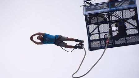 Ruben Davis makes the 160 feet bungee jump in aid of the Big C at the Forum. Picture: DENISE BRADLEY