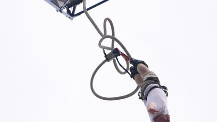 A jumper launches himself from the cage in a 160 feet bungee jump in aid of the Big C at the Forum.
