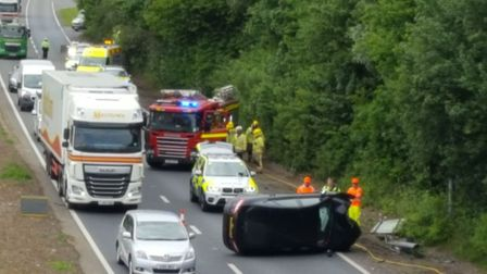 Overturned Ford Mondeo on A11 near Besthorpe. PICTURE: LL Construction