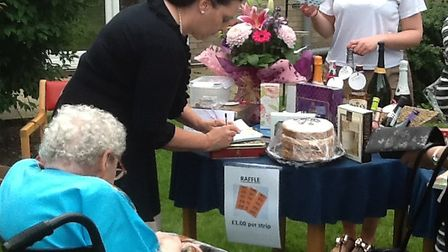 Visitors and residents enjoy the raffle at Thorp House nursing home's fete. Picture: Kingsley Health