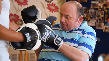 Mark Hobson, a resident at John Grooms Court for adults with physical and learning difficulties, tra