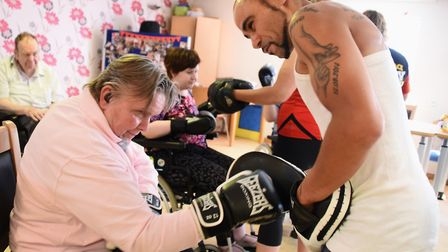 Norfolk amateur boxer, Zaiphan Morris, trains Rosie Woodgate, a resident at John Grooms Court for ad