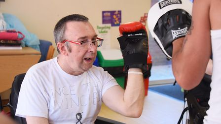 Vince Leighs, a resident at John Grooms Court for adults with physical and learning difficulties tra