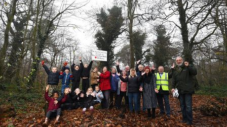 Friends of West Earlham Woods and pupils from West Earlham Infant School celebrate it becoming a loc