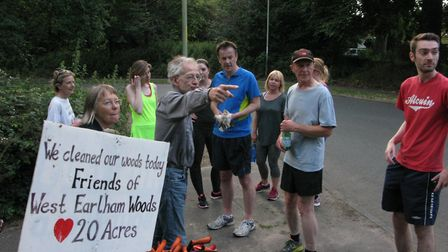 Noel Debbage (centre) of the Friends of the West Earlham Woods directs a clean up initiative at the