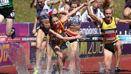 Iona Lake (centre) stumbles as she comes out of the water during the Women's 3000 Metres Steeplechas