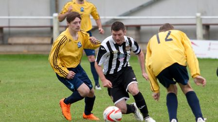 Swaffham Town captain Alex Vincent swerves through the St. Andrews defence during Saturday's friendl